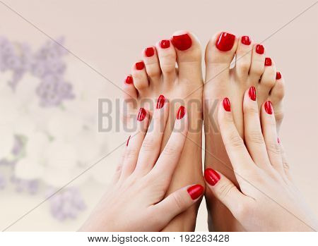 Feet hands manicure pedicure cure red background