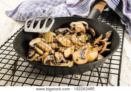 grilled mushroom with thyme in a pan