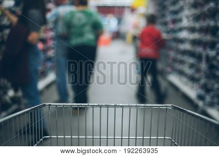 view from the cart on blured store, inside the cart