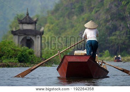 Perfume Pagoda. Woman delivering packages on the Suoi Yen River leading up to the Perfume Pagoda