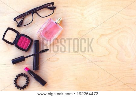 Different makeup cosmetics on the wooden table