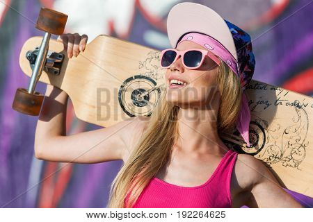 Happy young woman longboard young adult sport background