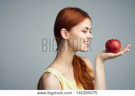 Diet, fruit, food, apple, girl on a gray background, diet, healthy diet, health, beauty.