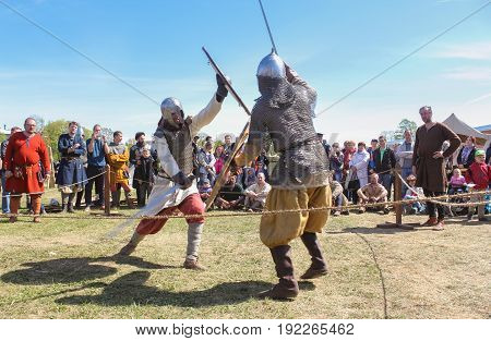 St. Petersburg Russia - 28 May, Attack in the battle with swords, 28 May, 2017. Knight tournament at the festival of ancient Vikings in St. Petersburg.