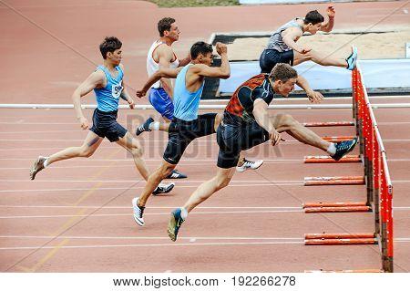 Chelyabinsk Russia - June 4 2017: men runners running race in 110 meter hurdles during UrFO Championship in athletics