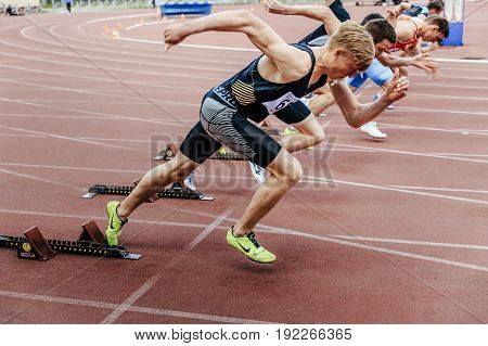 Chelyabinsk Russia - June 4 2017: start sprinters runners men running 100 meters during UrFO Championship in athletics