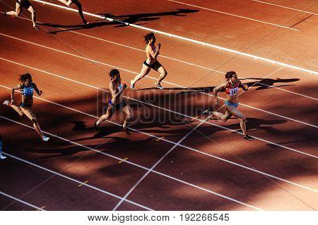 Chelyabinsk Russia - June 4 2017: group runners women run sprint race at stadium during UrFO Championship in athletics