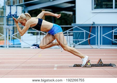 Chelyabinsk Russia - June 4 2017: explosive start female athlete sprinter run 200 meters during UrFO Championship in athletics