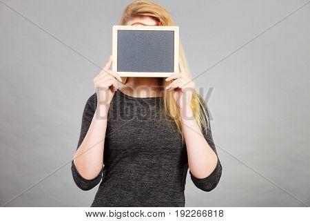 Woman Holding Blank Black Board On Face