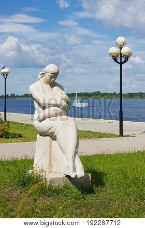 Statue of mother and baby on the bank of the Volga Russia