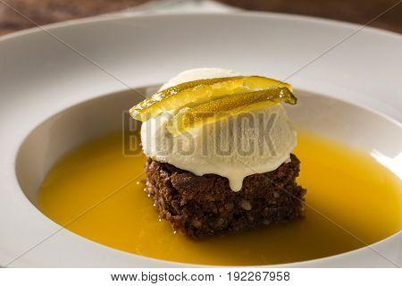 Chocolate Cookie With Ice Cream And Orange Sauce