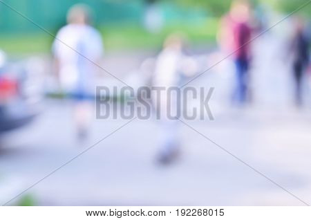 Defocused and blurred image for background of boy skating on skateboard