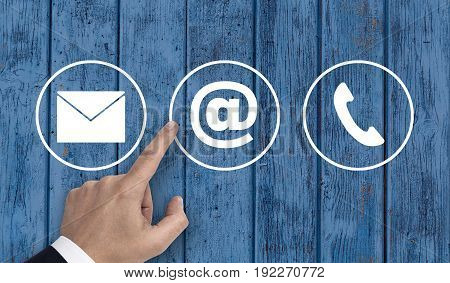 Hand pointing at contact options pictures concept