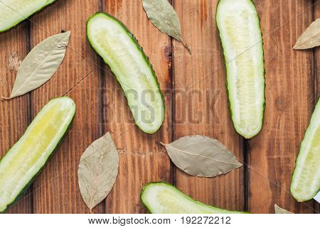 Fresh Cucumbers In Slit On Wooden Background.