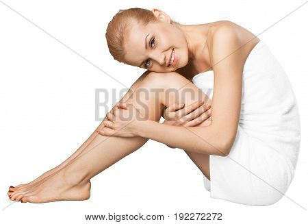 Full view of beautiful happy woman in a white towel on a white background.