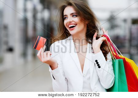 Beautiful Woman Purchasing By Credit Card