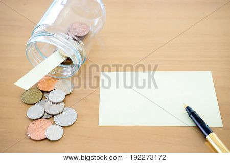 Money jar with U.S. currency represents savings donations concepts.