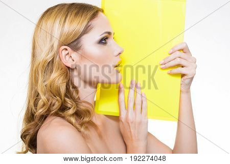 model on a white background with yellow plate for ads