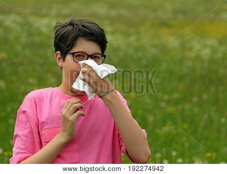 Young Boy With Allergy Blows His Nose