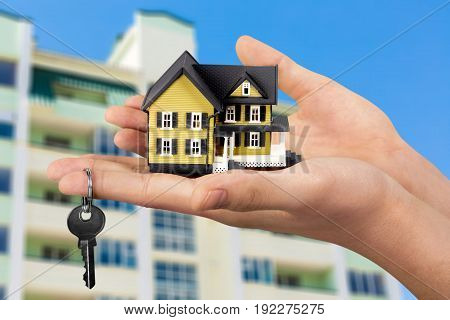 model house in hand with key closeup business