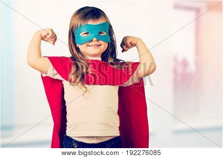 Girl in costume superhero elementary age preadolescent child fun