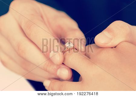 Wedding diamond ring close-up celebration holding