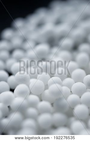 Background with spherical homeopathic pills close up