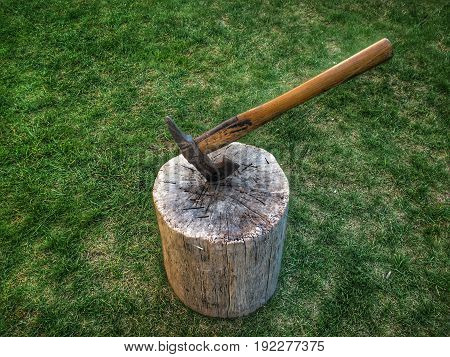 axe in a stump , for chopping firewood.