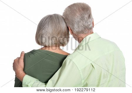 Rear view of senior couple isolated on white background