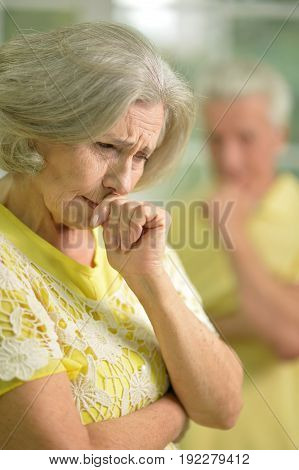 Close-up portrait of a stressed senior woman