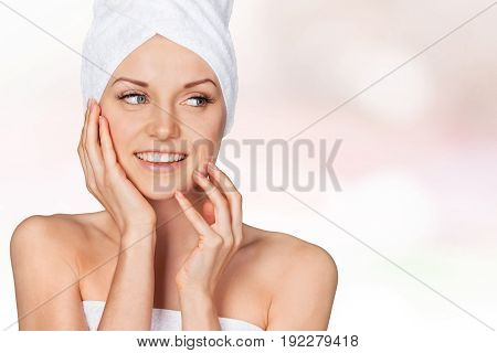 Beautiful happy woman with white towel on her head.