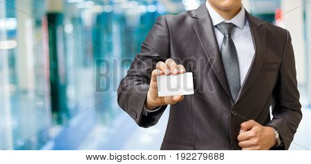 Businessman Shows A Payment Card .