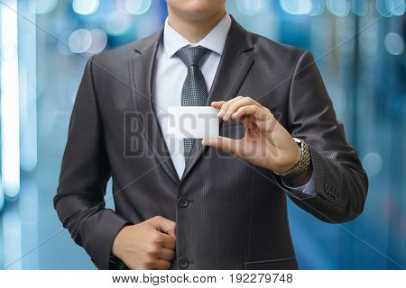 Business Man Holding A Global Financial Market.