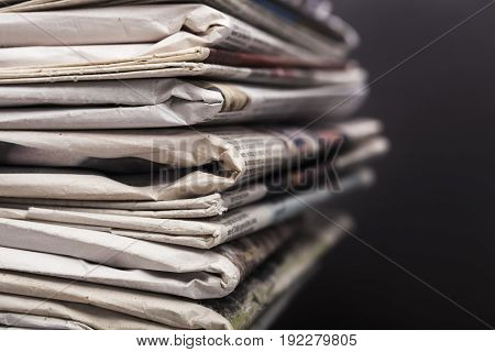 pile newspapers print media paper stack