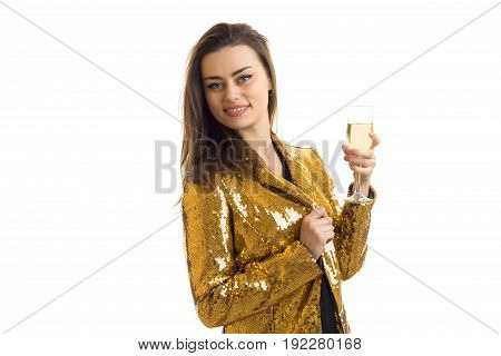 Cheerful girl with glasses of wine in golden jacket smiling on camera isolated on white background