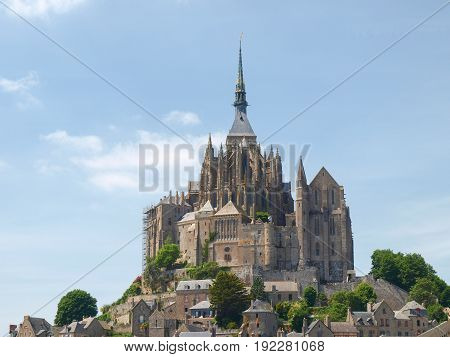 Mont St. Michel, France - June 13, 2014: Abbey of Mont St. Michel. View of the Abbey from the sands at low tide.