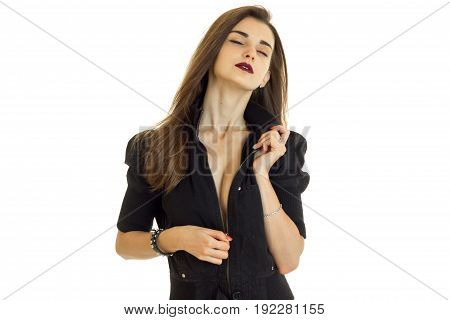 Sensual young girl with closed eyes unbuttons a black jacket isolated on white background