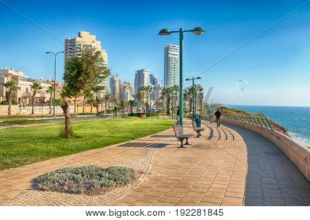 NETANYA, ISRAEL - AUGUST 29, 2015: Modern promenade on Mediterranean sea coast, Netanya, Israel