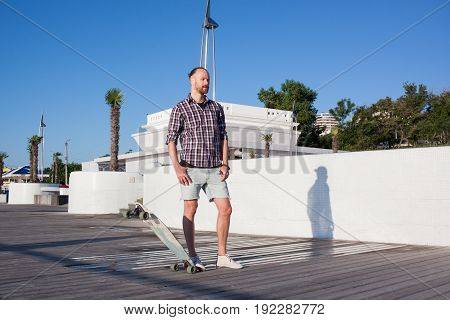 young handsome skater posing, summertime liftyle picture
