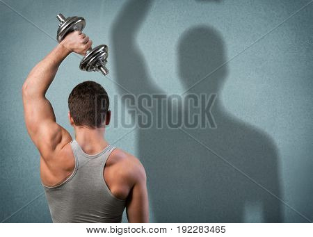 Man exercise dumbbell back view sport background person