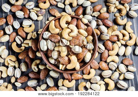 Mixed Nuts On Wooden Background. Healthy Food And Snack.