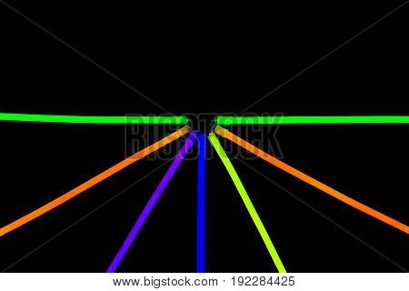 Glow sticks neon light fluorescent on back background. variation of different colored chem lights like the sun or star