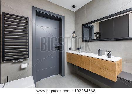 Dark Bathroom With Countertop Basin