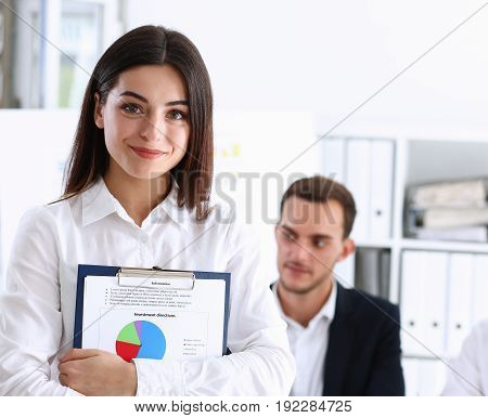 Businesswoman in white shirt holding clipboard with infograth