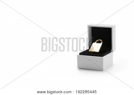 Golden security lock in a jewelry box against white background