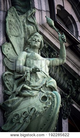 A beautiful statue of the sea goddess on the facade of a building in St. Petersburg