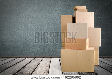 Cardboard boxes different sizes on wooden background