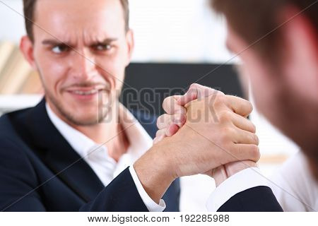 Woman and man in suit hold hands in wrestle. Strong people battle portrait female emancipation feminism war white collar rival game aggressive expression agreement effort arbitration concept