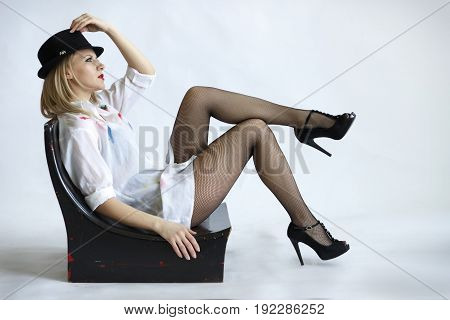 woman in hat on chair isolated on white background close-up