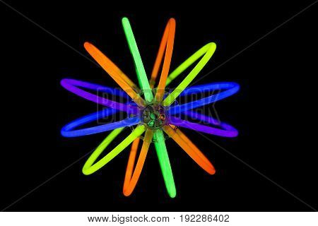 Glow sticks neon light fluorescent on back background. variation of different colored chem lights like a ball
